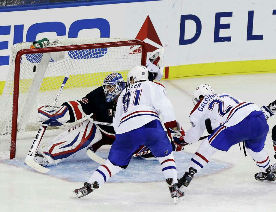 Montreal Canadiens' Alex Galchenyuk (27) scores a goal on New York Rangers goalie Henrik Lundqvist (30), of Sweden, as teammate Lars Eller (81), of Denmark, watches during the third period of an NHL hockey game, Tuesday, Feb. 19, 2013, in New York. The Canadiens won 3-1. (AP Photo/Frank Franklin II) Photo: Frank Franklin II