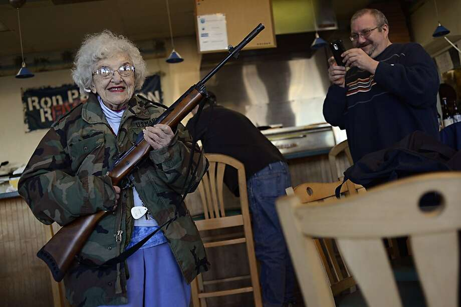 Locked and loaded with calories: All customers carrying weapons get 15 percent off at All Around Pizza and Deli in Virginia Beach, Va. And when Thelma Lazernick orders extra cheese, she means it, mister. Photo: Amanda Lucier, Associated Press