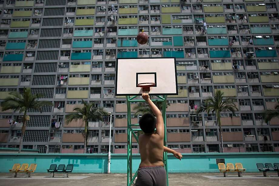 A man plays basketball in front of a public housing estate in Choi Hung on February 19, 2013 in Hong Kong. One of the most densely populated countries in the world is Hong Kong, with a population of over 7.1 million inhabitants in an area of 1100 square kilometres. Photo: Lam Yik Fei, Getty Images