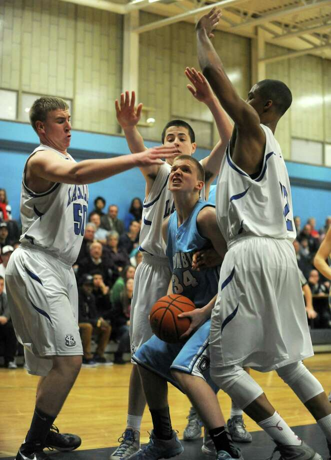 Columbia's Steven Hart looks for an opening during their Class AA boy's basketball playoff game against LaSalle on Tuesday Feb. 19, 2013 in Troy, N.Y. .(Michael P. Farrell/Times Union) Photo: Michael P. Farrell