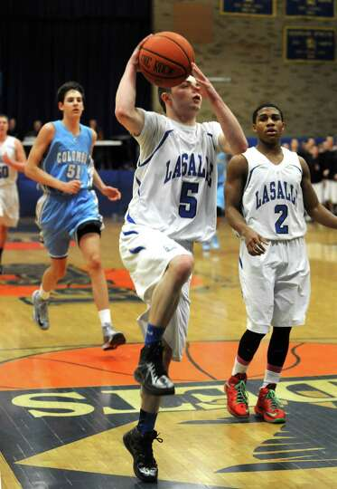 LaSalle's Ralph Erickson drives to the basket during their Class AA boy's basketball playoff game ag