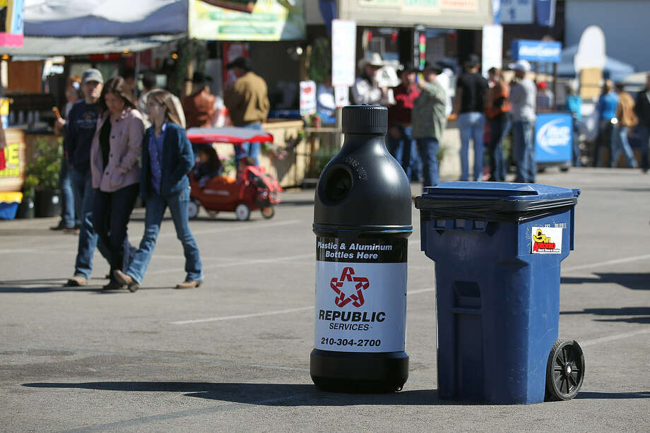 Recycling containers are next to trash cans throughout the Stock Show & Rodeo grounds, including at the Food Court. Photo: Jerry Lara / San Antonio Express-News