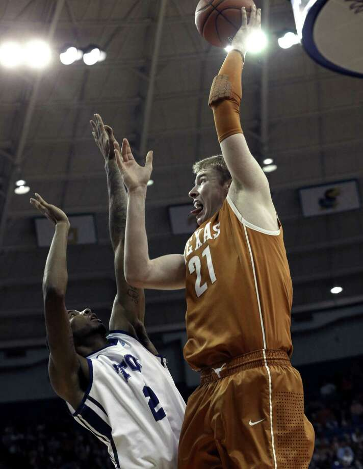 UT forward Connor Lammert shoots over TCU's Connell Crossland during the Horns' 68-59 win in Fort Worth. Photo: L.M. Otero / Associated Press