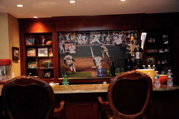 "Gary Dell'Abate's has a ""man cave"" in his house, in Greenwich, Conn., Monday, Feb. 18, 2013.  Dell'Abate, the longtime Howard Stern sidekick and Old Greenwich resident, is co-host of a new VH1 Classic show on music and pop culture memorabilia called ""For What It's Worth."" Photo: Helen Neafsey / Greenwich Time"