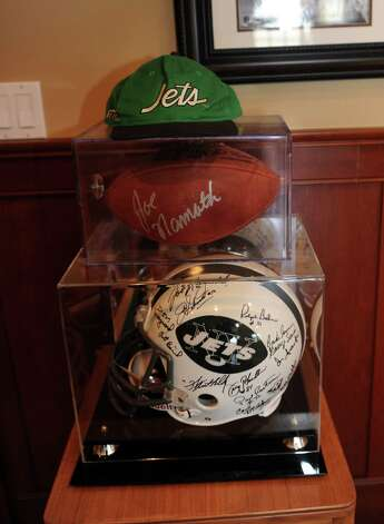 "Gary Dell'Abate has  a group of Jet helmets in his ""man cave"" in his house, in Greenwich, Conn., Monday, Feb. 18, 2013. Gary Dell'Abate, the longtime Howard Stern sidekick and Old Greenwich resident, is co-host of a new VH1 Classic show on music and pop culture memorabilia called ""For What It's Worth."" Photo: Helen Neafsey / Greenwich Time"
