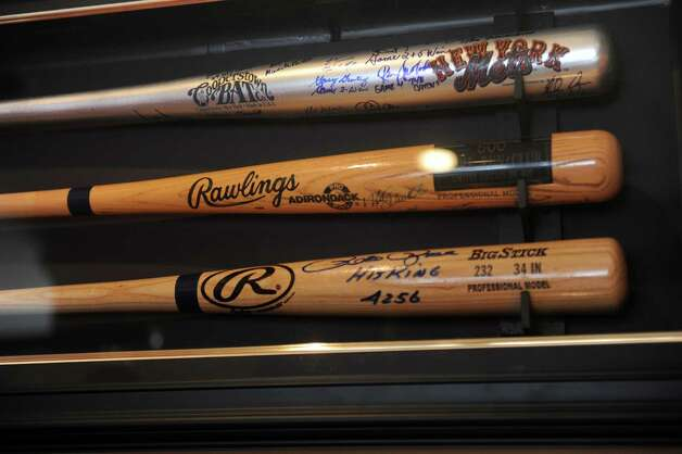 "Autographed bats, including one signed by ""hit king"" Peter Rose, fill a display case in the Old Greenwich, Conn., home of Gary Dell'Abate, Monday, Feb. 18, 2013. Dell'Abate, the longtime Howard Stern sidekick and Old Greenwich resident, is co-host of a new VH1 Classic show on music and pop culture memorabilia called ""For What It's Worth."" Photo: Helen Neafsey / Greenwich Time"