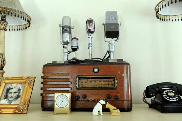 "A wooden radio and vintage microphones adorn a mantle in the Old Greenwich, Conn., living room of Gary Dell'Abate Monday, Feb. 18, 2013. Dell'Abate, the longtime Howard Stern sidekick and Old Greenwich resident, is co-host of a new VH1 Classic show on music and pop culture memorabilia called ""For What It's Worth."" Photo: Helen Neafsey / Greenwich Time"