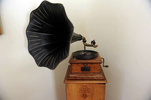 "An antique gramophone stands in the living room of Gary Dell'Abate, in Greenwich, Conn., Monday, Feb. 18, 2013. Gary Dell'Abate, the longtime Howard Stern sidekick and Old Greenwich resident, is co-host of a new VH1 Classic show on music and pop culture memorabilia called ""For What It's Worth."" Photo: Helen Neafsey / Greenwich Time"