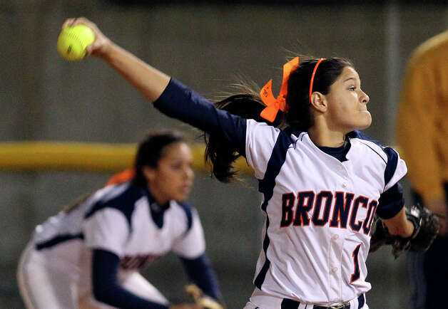 Brandeis softball pitcher Cameron Cruze along with other teammates wear orange ribbons with the initials of former teammate Gabriella Lerma on the ribbon during a game against O'Connor High School to remember Lerma who died in a drag racing incident on Tuesday, Feb. 19, 2013. Lerma was a junior at Brandeis. Photo: Kin Man Hui, San Antonio Express-News / © 2012 San Antonio Express-News