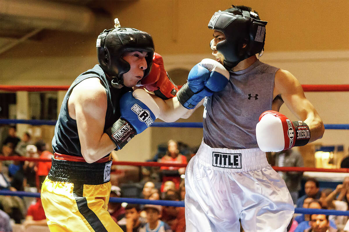 Domingo Rios with Zarzamora Street Gym (left) and Johnny Moreno with Texas Woverine Allstars trade punches during their novice Bantam bout on opening night of the 2013 San Antonio Regional Golden Gloves tournament at Woodlawn Gym on Tuesday, Feb. 19, 2013. Moreno won the bout.