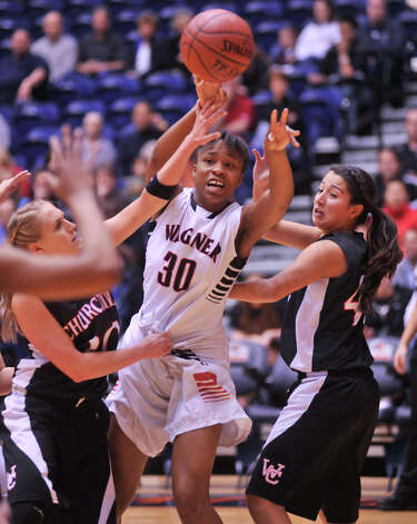 Wagner's Tesha Smith passes between Churchill's Leslie Vorpahl and Victoria Guerra during action in their 5A playoff game Tuesday, Feb. 19, 2013. Photo: Robin Jerstad, Robin Jerstad, For The Express-News
