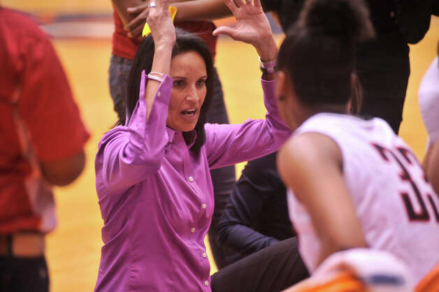 Wagner coach Christina Camacho talks to her players during a timeout of their 5A playoff game against Churchill Tuesday night, Feb. 19, 2013. Photo: Robin Jerstad, Robin Jerstad, For The Express-News