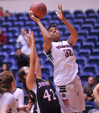Wagner's Kiana Clark shoots over Churchill's Victoria Guerra during their 5A playoff game Tuesday, Feb. 19, 2013. Photo: Robin Jerstad, Robin Jerstad, For The Express-News