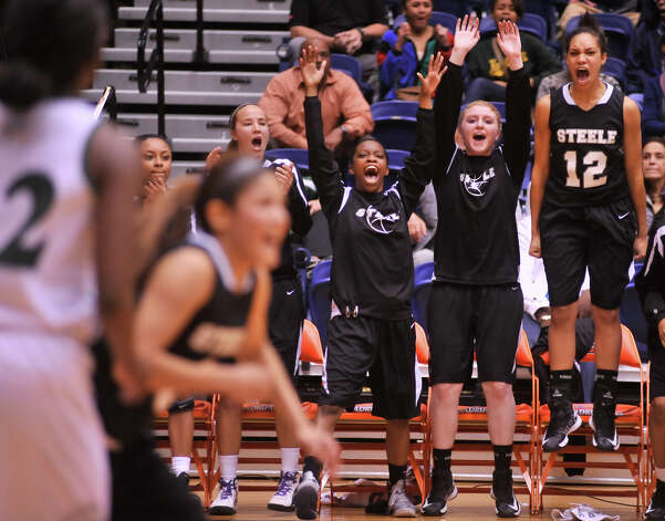 Players on the Steele bench react to a late basket during their 5A playoff win over Reagan Tuesday night, Feb. 19, 2013. Photo: Robin Jerstad, Robin Jerstad, For The Express-News