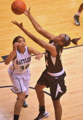 Steele's Erika Chapman grabs a rebound away from Reagan's Briana Gladney during their 5A playoff contest Tuesday, Feb. 19, 2013. Photo: Robin Jerstad, Robin Jerstad, For The Express-News