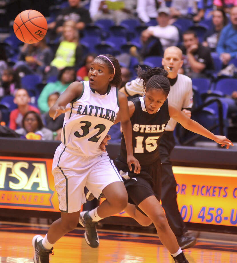 Reagan's Moriah Mack (32) nearly loses the ball as Steele's Kyra Lambert defends during their 5A playoff game Tuesday, Feb. 19, 2013. Photo: Robin Jerstad, Robin Jerstad, For The Express-News