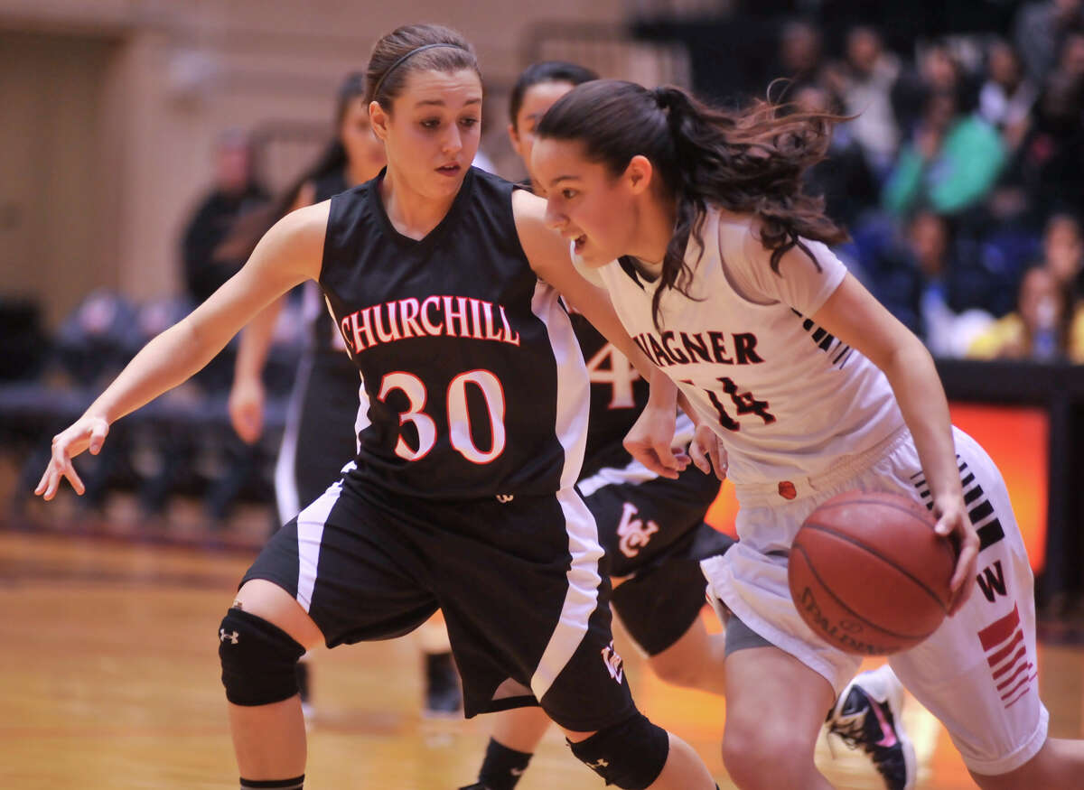 Wagner's Amber Ramirez tries to drive past Churchill's Bailee Weinheimer during their 5A playoff game Tuesday, Feb. 19, 2013.