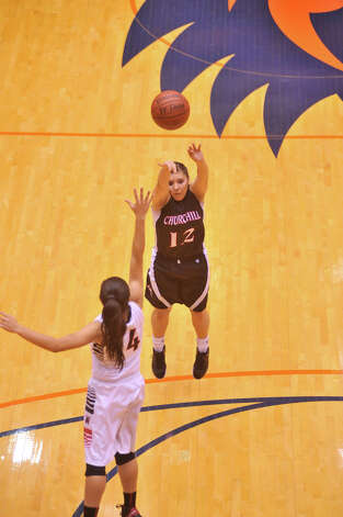 Churchill's Mikki Flores shoots over Wagner's Amber Ramirez during their 5A playoff game Tuesday, Feb. 19, 2013. Photo: Robin Jerstad, Robin Jerstad, For The Express-News