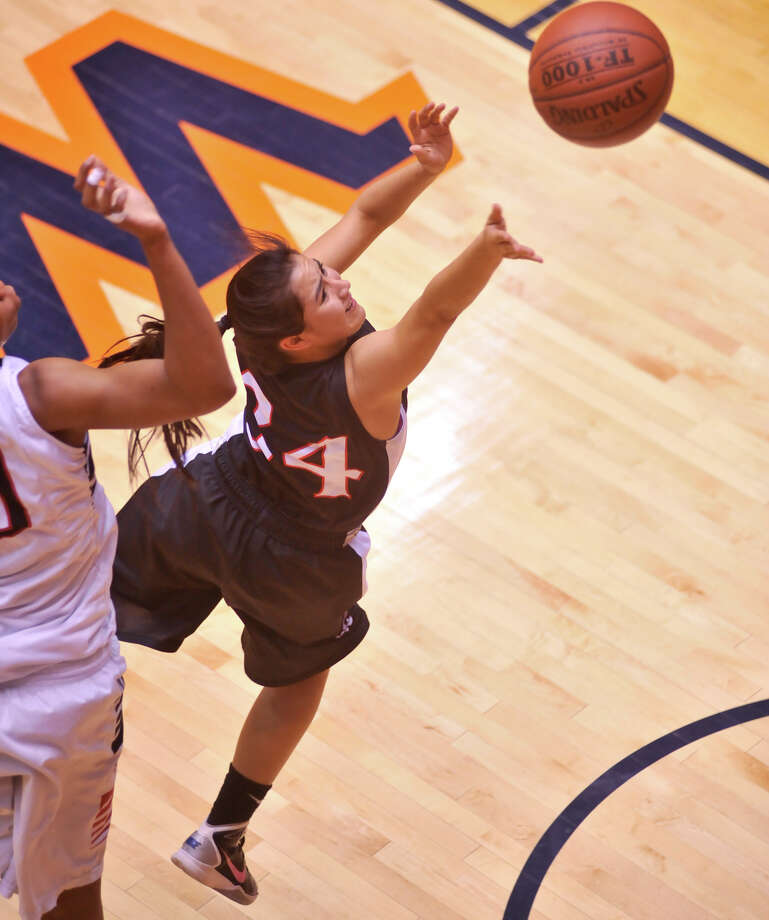 Churchill's Crystal Millice puts up a shot past Wagner's Tesha Smith during their 5A playoff game Tuesday, Feb. 19, 2013. Photo: Robin Jerstad, Robin Jerstad, For The Express-News