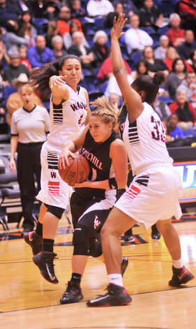 Churchill's Ashley Ross (20) tries to drive between Wagner's Anabelle Tovar (4) and Kaelynn Wilson during action in their 5A playoff game Tuesday evening, Feb. 19, 2013. Photo: Robin Jerstad, Robin Jerstad, For The Express-News