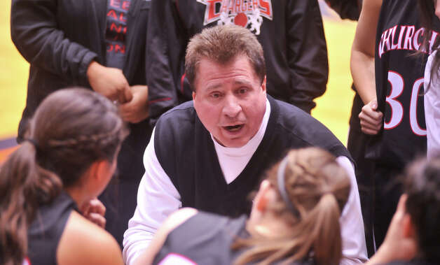 Churchill coach Cal Wulfsberg talks to his player during a timeout of their 5A playoff game versus Wagner Tuesday, Feb. 19, 2013. Photo: Robin Jerstad, Robin Jerstad, For The Express-News