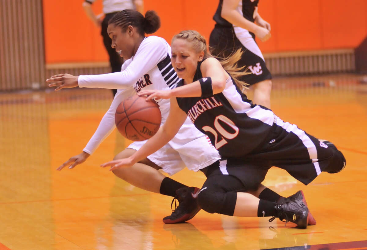Wagner's Ashley Ross and Churchill's Leslie Vorpahl battle for a loose ball during their 5A playoff game Tuesday, Feb. 19, 2013.