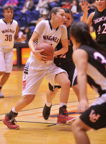 Wagner's Amber Ramirez drives to the basket in their 5A playoff game versus Churchill Tuesday, Feb. 19, 2013. Photo: Robin Jerstad, Robin Jerstad, For The Express-News