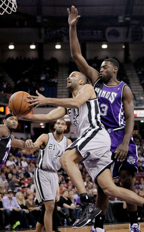 San Antonio Spurs guard Tony Parker, of  France, drives to the basket past  Sacramento Kings guard Tyreke Evans, right, during the first quarter of an NBA basketball game in Sacramento, Calif., Tuesday, Feb. 19, 2013. Photo: Rich Pedroncelli, Associated Press / AP