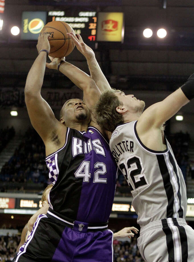 Sacramento Kings forward Chuck Hayes, left, and San Antonio Spurs center Tiago Splitter, of Brazil, battle for the ball during the fourth quarter of an NBA basketball game in Sacramento, Calif., Tuesday, Feb. 19, 2013. The Spurs won 108-102. Photo: Rich Pedroncelli, Associated Press / AP