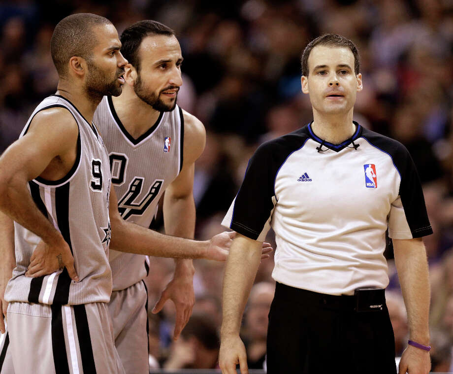 San Antonio Spurs' Tony Parker, of France, left, and Manu Ginobili, of Argentina, center, question Official Mark Lindsay about a call during the fourth   quarter of an NBA basketball game in Sacramento, Calif., Tuesday, Feb. 19, 2013. The Spurs won 108-102. Photo: Rich Pedroncelli, Associated Press / AP