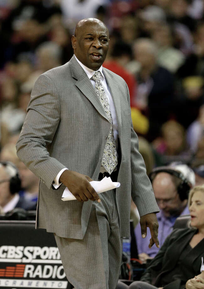 Sacramento Kings head coach Keith Smart, questions a foul call during the fourth quarter against the San Antonio Spurs in a NBA basketball game in Sacramento, Calif., Tuesday, Feb. 19, 2013. The Spurs won 108-102. Photo: Rich Pedroncelli, Associated Press / AP