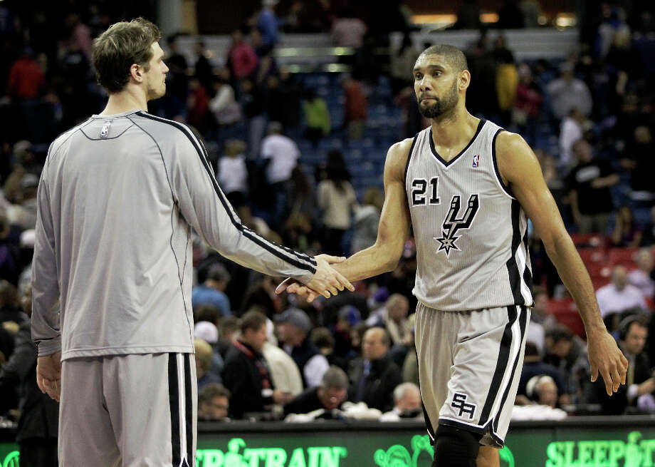 San Antonio Spurs center Tiago Splitter, of Brazil, left, shakes hands with teammate Tim Duncan after defeating the Sacramento Kings in a NBA basketball game in Sacramento, Calif., Tuesday, Feb. 19, 2013. The Spurs won 108-102. Photo: Rich Pedroncelli, Associated Press / AP