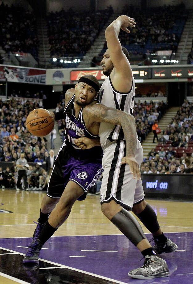 Sacramento Kings center DeMarcus Cousins, left, drives on San Antonio Spurs forward Boris Diaw, of France, during the third quarter of an NBA basketball game in Sacramento, Calif., Tuesday, Feb. 19, 2013. The Spurs won 108-102. Photo: Rich Pedroncelli, Associated Press / AP