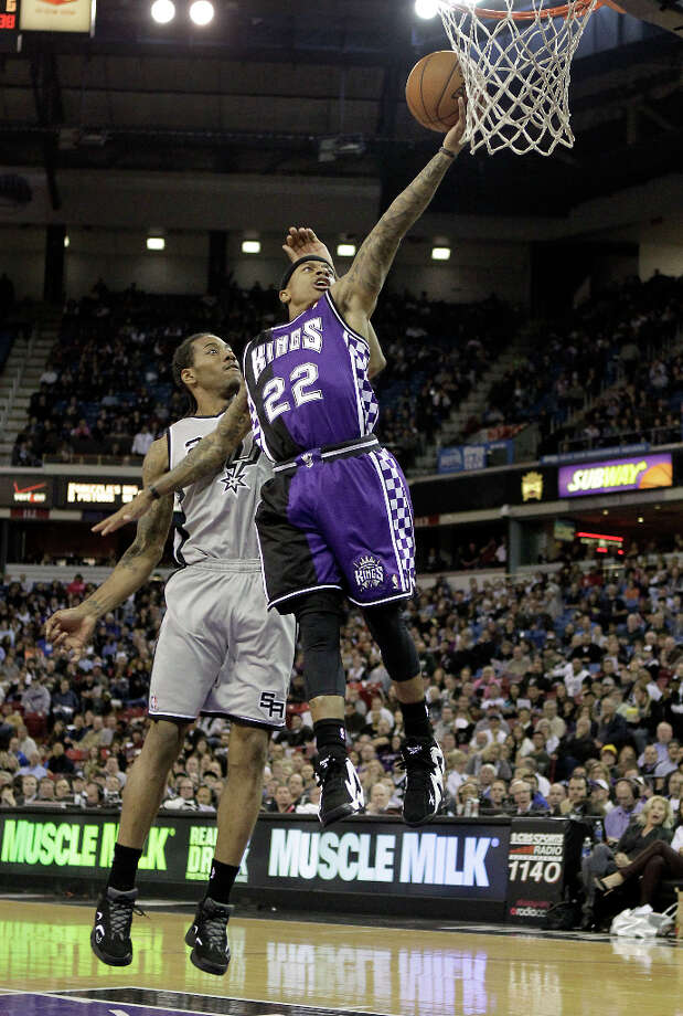 Sacramento Kings Isaiah Thomas, right, goes to the basket past San Antonio Spurs guard Danny Green, during the third quarter of an NBA basketball game in Sacramento, Calif., Tuesday, Feb. 19, 2013. The Spurs won 108-102. Photo: Rich Pedroncelli, Associated Press / AP