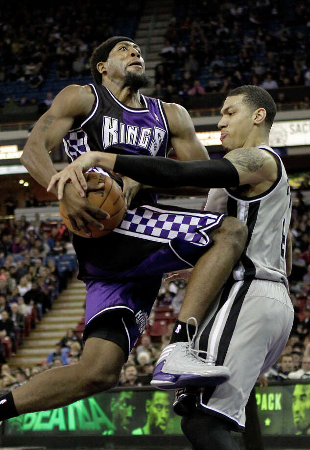 Sacramento Kings forward John Salmons, left, has his shot blocked by San Antonio Spurs guard Danny Green, forcing a jump ball during the third quarter of an NBA basketball game in Sacramento, Calif., Tuesday, Feb. 19, 2013. The Spurs won 108-102. Photo: Rich Pedroncelli, Associated Press / AP