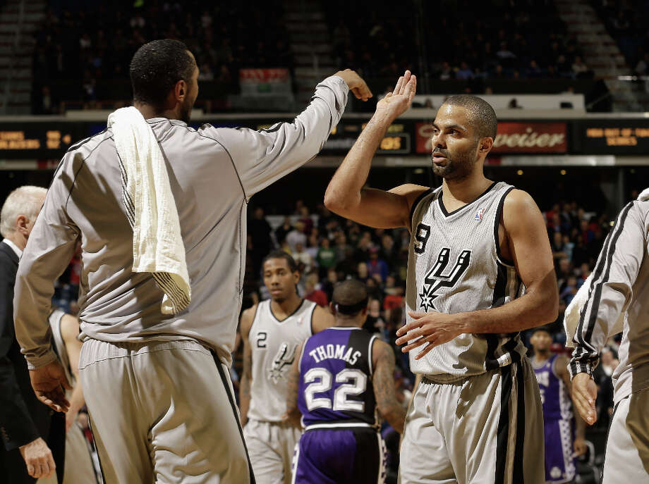 Tony Parker #9 of the San Antonio Spurs is congratulated by teammates during a time out of their win over the Sacramento Kings at Sleep Train Arena on February 19, 2013 in Sacramento, California. Photo: Ezra Shaw, Getty Images / 2013 Getty Images