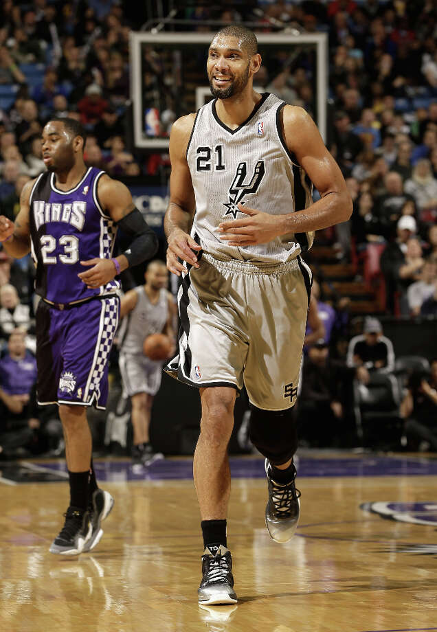 Tim Duncan #21 of the San Antonio Spurs smiles as he runs down court during their win over the Sacramento Kings at Sleep Train Arena on February 19, 2013 in Sacramento, California. Photo: Ezra Shaw, Getty Images / 2013 Getty Images