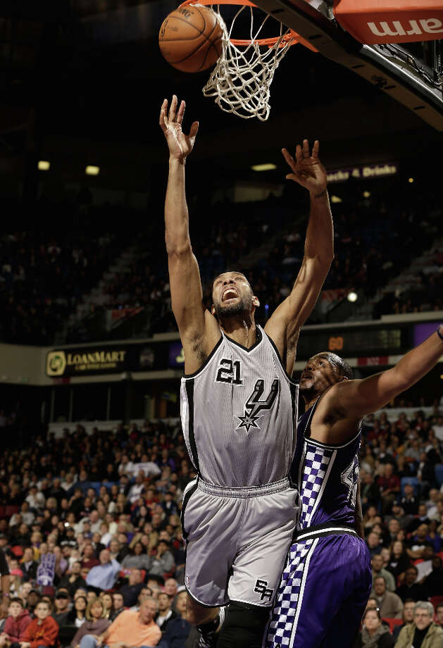 Tim Duncan #21 of the San Antonio Spurs is fouled by Chuck Hayes #42 of the Sacramento Kings at Sleep Train Arena on February 19, 2013 in Sacramento, California. Photo: Ezra Shaw, Getty Images / 2013 Getty Images