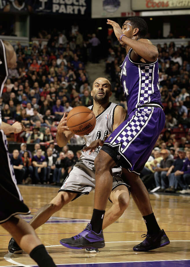Tony Parker #9 of the San Antonio Spurs tries to dribble around Jason Thompson #34 of the Sacramento Kings at Sleep Train Arena on February 19, 2013 in Sacramento, California. Photo: Ezra Shaw, Getty Images / 2013 Getty Images