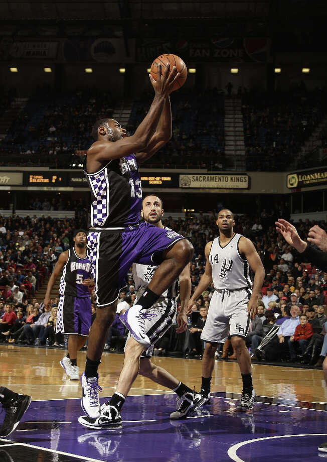 Tyreke Evans #13 of the Sacramento Kings goes up for a shot against the San Antonio Spurs at Sleep Train Arena on February 19, 2013 in Sacramento, California. Photo: Ezra Shaw, Getty Images / 2013 Getty Images