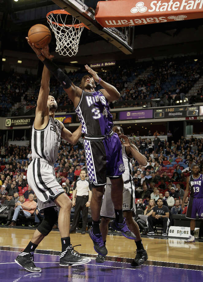 Jason Thompson #34 of the Sacramento Kings shoots over Tim Duncan #21 of the San Antonio Spurs at Sleep Train Arena on February 19, 2013 in Sacramento, California. Photo: Ezra Shaw, Getty Images / 2013 Getty Images