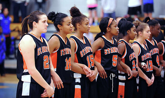 The Stamford Girls high school basketball team during the start of the FCIAC semifinal game between Stamford High School and Trumbull High School at Fairfield-Ludlowe High School, Tuesday, Feb. 19, 2013. Photo: Bob Luckey / Greenwich Time