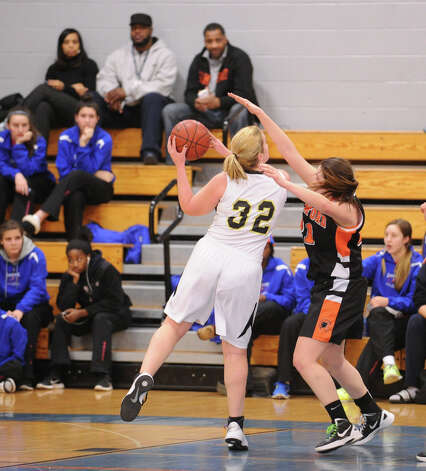 Erin Moore # 32 of Trumbull drives to the basket during the girls high school basketball FCIAC semifinal game between Stamford High School and Trumbull High School at Fairfield-Ludlowe High School, Tuesday, Feb. 19, 2013. Photo: Bob Luckey / Greenwich Time