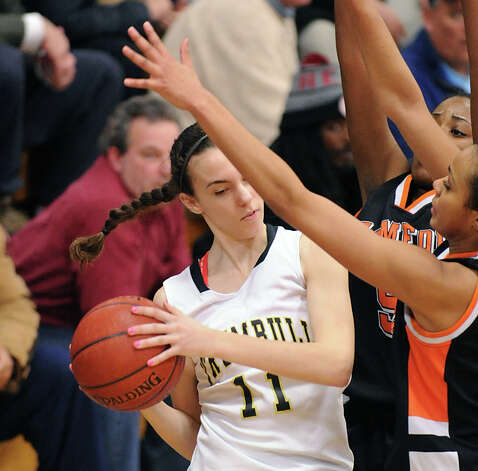 At left, Rachel Carron # 11 of Stamford during the girls high school basketball FCIAC semifinal game between Stamford High School and Trumbull High School at Fairfield-Ludlowe High School, Tuesday, Feb. 19, 2013. Photo: Bob Luckey / Greenwich Time