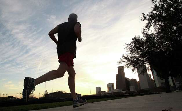 An early morning runner makes his way along Allen Parkway into Downtown on Tuesday, Feb. 19, 2013, in Houston. Photo: Mayra Beltran, Houston Chronicle / © 2013 Houston Chronicle
