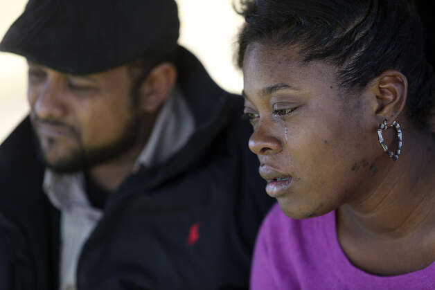 Shontae Minor and boyfriend Khristian Rohena grieve during the funeral for son Ryan Nico, the second of the quadruplets to die. Photo: Photos By Lisa Krantz / San Antonio Express-News