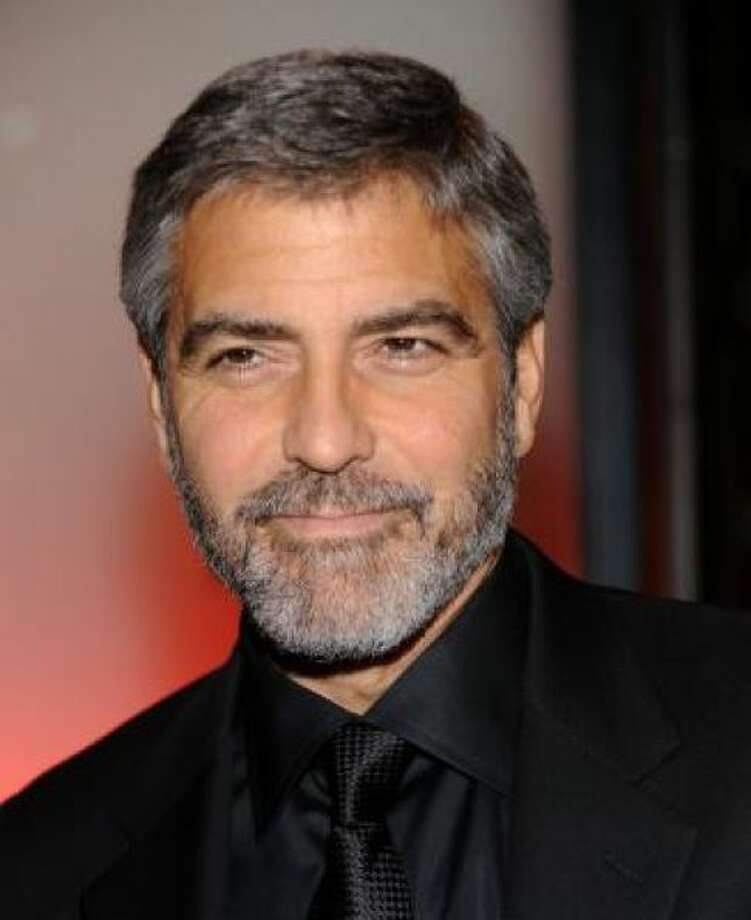 George Clooney looking gorgeous with a gray beardPHOTO BY EVAN AGOSTINI/AP