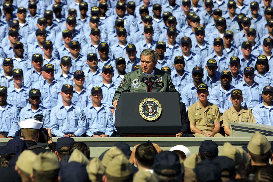 President George W. Bush speaks to approximately 8,000 U.S. sailors at the Naval Station Mayport February 13, 2003 in Jacksonville, Florida. President Bush stated that the U.S. is prepared to win a war with Iraq, should it occur, while urging the United Nations Security Council to enforce demands that Iraqi President Saddam Hussein disarm. Photo: Chris Livingston, Getty Images / 2003 Getty Images