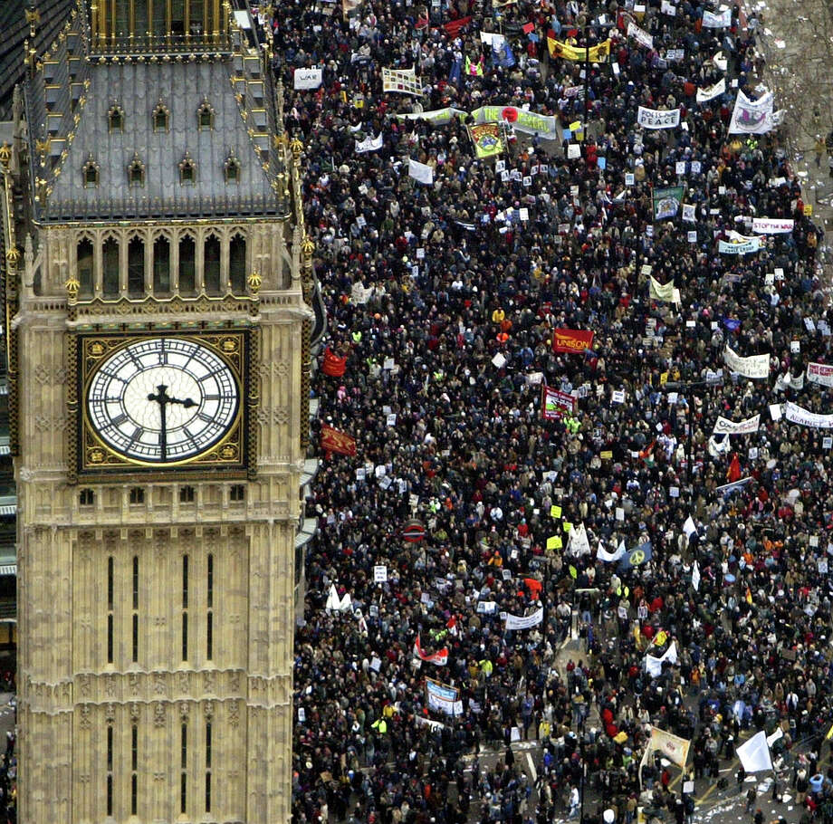 Several hundred thousand people march past the Westminster Clock Tower (Big Ben) towards Hyde Park to protest against the proposed war in Iraq February 15, 2003 in London. Similar massive demonstrations are taking place all over the world as the U.S. and Britain continue to press for a UN Security Council resolution for war. Photo: Ian Waldie, Getty Images / 2003 Getty Images