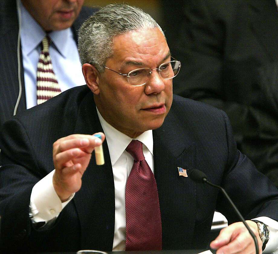U.S. Secretary of State Colin Powell holds a vial representing the small amount  of Anthrax that closed the U.S. Senate last year during his address to the UN Security Council February 5, 2003 in New York City. Powell is making a presentation attempting to convince the world that Iraq is deliberately hiding weapons of mass destruction. Photo: Mario Tama, Getty Images / 2003 Getty Images
